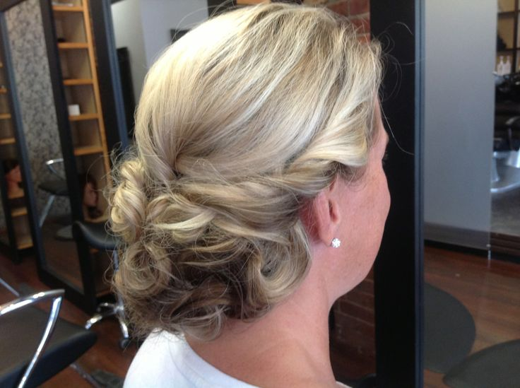 This was a client who came from New York to go to a friends wedding. My favorite chignon. Her hair color really lends to the style.