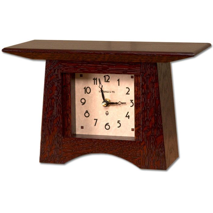 "A beautiful mantel clock made of Quartersawn White Oak with ""Craftsman Oak"" finish. Both the dial and the clocks hands are covered in glass. Details Dimensions: 10 x 5.5 x 4 inches Quartz movement wit"