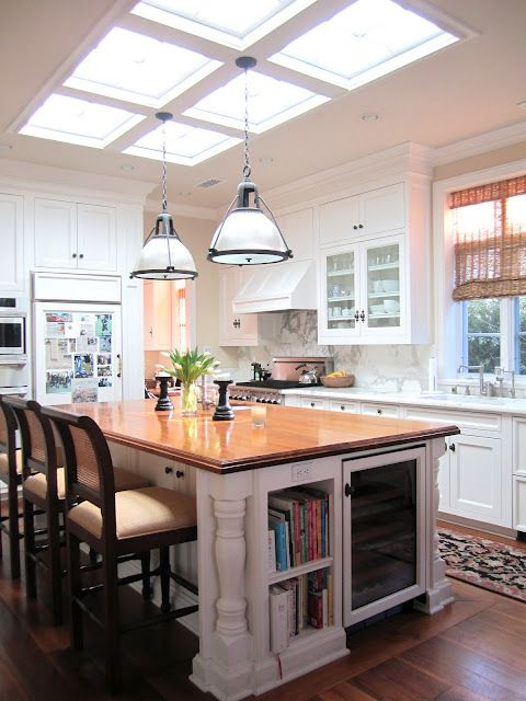 I like the design of the island with space for cookbooks and chairs, definitely want an island at my house