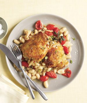 Chicken With White Beans and Tomatoes|Fresh thyme and oregano infuse this dish with wonderful aromas and flavors. The tomatoes will soften and release their juices as they roast, resulting in a delicious sauce.