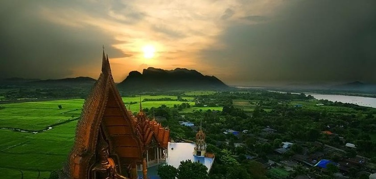 magnificent view of the paddy fields, Mae Klong Dam, the mountain range and the river.     Quite a number of these temples are built on top of caves, similarly with the Wat Tham Sua and the whole structure is interconnected with the cave system leading up to the hill. If you are willing to walk the flight of steps up (there is an elevator for those who have difficulty with steps) you will be rewarded by the great view.     http://www.facebook.com/pages/Point-Blank-Critique/452562314771048