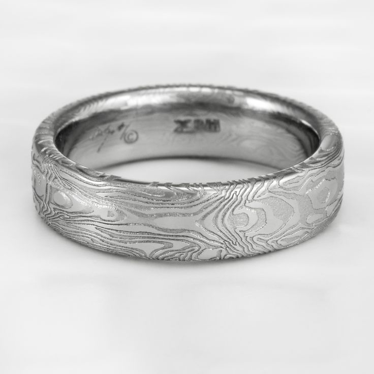 womens damascus wedding band with mirror image design by steven jacob on