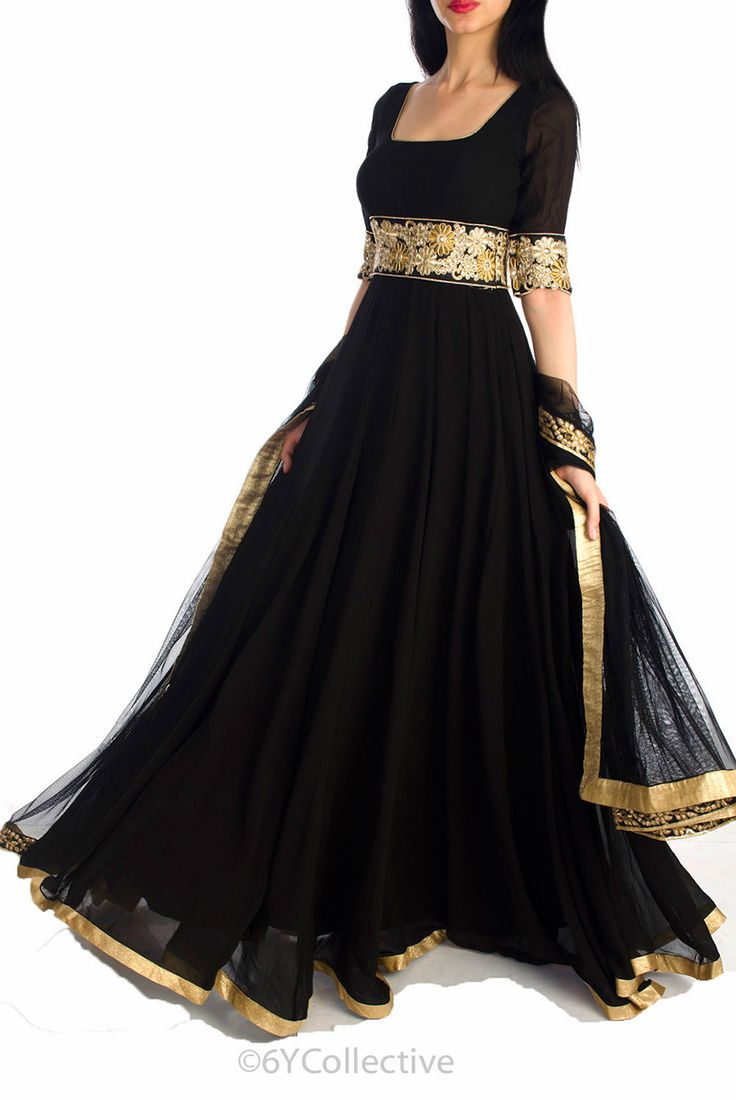 An exquisitely design,designer bollywood dress. Black floor length kali style anarkali in georgette with floral embroidered lace at the empire waist and rose gold border at the hemline. waist; square neck with deep scoop back Elbow Sleeves without lining paired with floral borders Black net dupatta with floral embroidery on all sides Rich embroidery in zari and resham adorns the waistline Fabric: Georgette visit -www.suitsaristore.com www.facebook.com/designersuitsandsari
