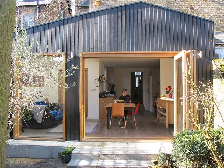 This is a small wrap-around extension to the rear of an existing Victorian semi-detached house. The rear and side walls of the existing building were removed to create open plan kitchen, dining and living spaces. The simple asymmetric form of the extension – which is expressed internally – creates a strong architectural aesthetic which relates back to the existing building through its shallow pitched roofs. The extension is clad with Russian Redwood finished with a natural black stain. This…