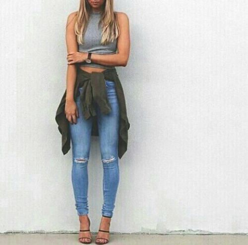 crop top, ripped skinny jeans, shirt tied around the waist, sandals.