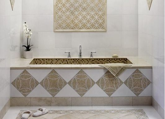 Beautiful Bathtub Decorated In Gold And White Tiles
