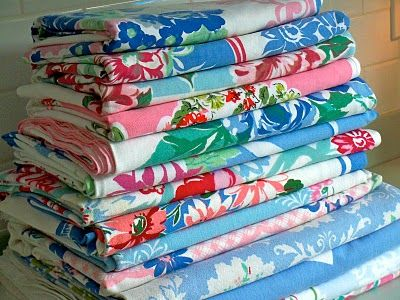 Love the colors of these old tablecloths- about the 1940s-1950s when my mom and grandma used them.