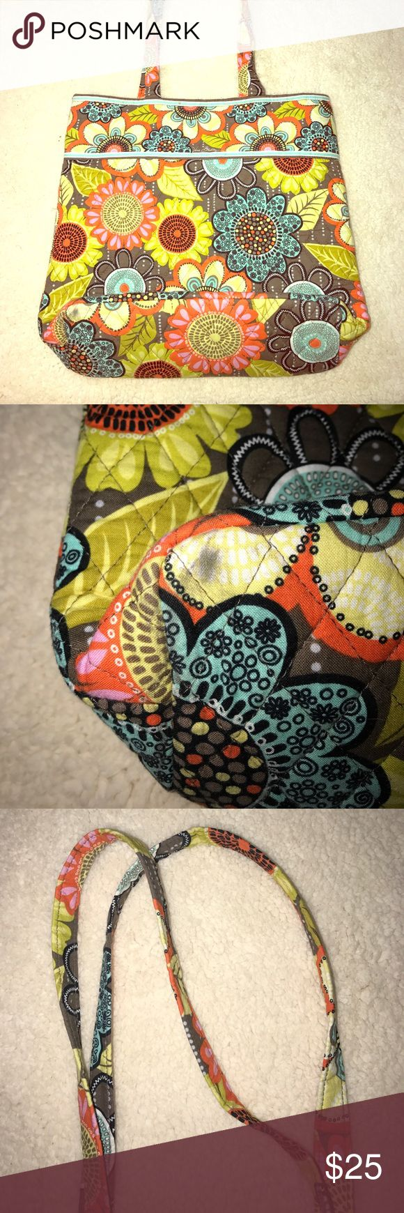 Gorgeous Vera Bradley Tote!  Great used Condition A beautiful vera Bradley tote bag perfect for school or work. Teals,  corals, yellows, and browns saturate this adorable bag. One noticeable mark on the bottom of the bag is shown in picture. Vera Bradley Bags Totes