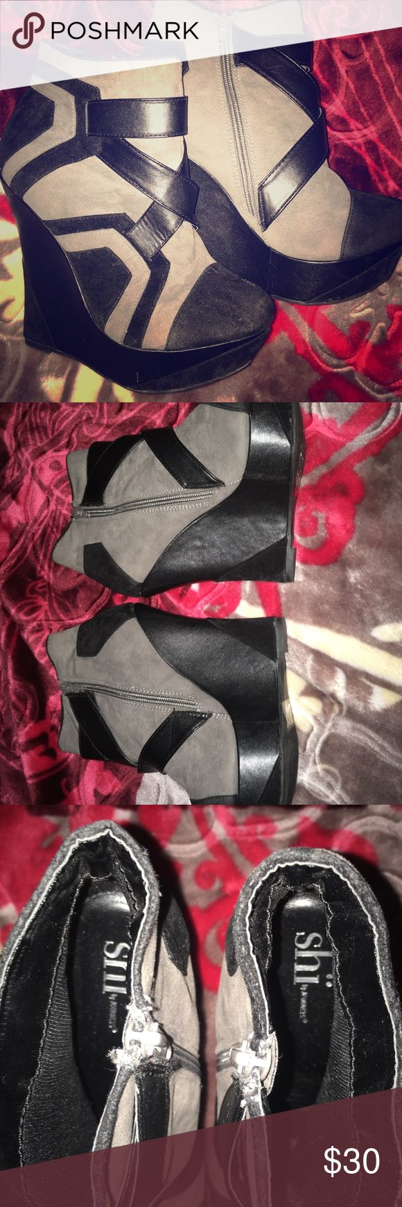 Shï Black/gray wedge pumps Size 7, worn maybe once in great condition. About 4 inch heel with some fabric insulation inside shoe for comfort. Zip up on sides. Shï By Journeys Shoes Wedges
