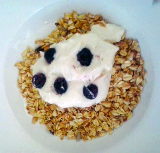 Tracey's delicious homemade granola with oats, macadamia nuts, chia, almonds, coconut served with yoghurt and blueberries.