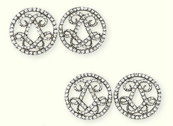 A PAIR OF ANTIQUE DIAMOND CUFFLINKS   Each circular openwork panel with rose-cut diamond border and entwined double L monogram, mounted in silver and gold, circa 1900, with French assay marks for gold and maker's mark