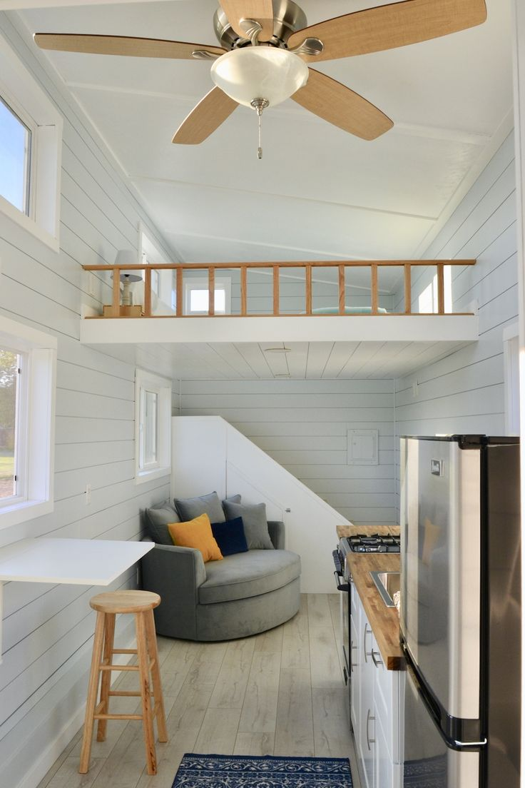 Stairs up the back wall with built in drawers
