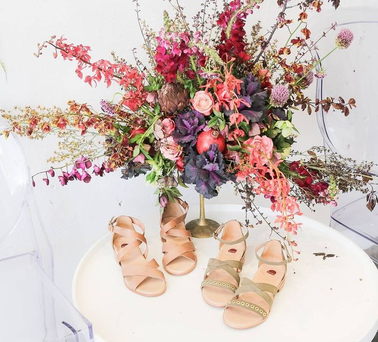 Get excited our summer sandal collection has arrived! Which of these two sandals would you wear?  Shop now via link in bio.  On a side note how beautiful are these blooms from @bud_flowers