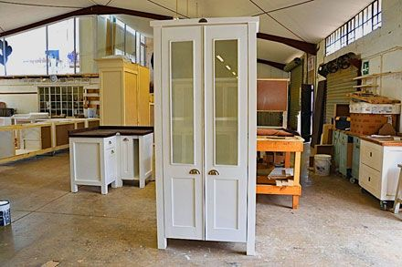 We are hard at work in the Milestone Factory, counting down the days until our annual Christmas break. This picture shows a Swedish Style Grocery Cupboard with Glass Doors ready to be delivered to Pretoria. It also shows our lovely new insulated ceiling and the area enclosed by glass where our Coffee Shop is.