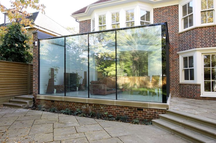 External view of the frameless glass box extension showing for Sunroom extensions sydney