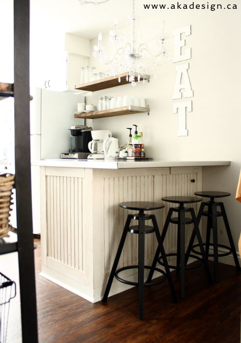 Breakfast bar in this small kitchen - love the EAT sign and open shelves eclecticallyvintage.com
