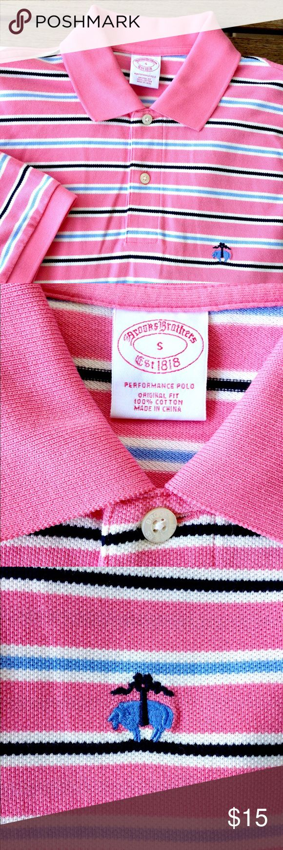 "BROOKS BROTHERS - Pink Striped Polo Shirt NWOT - Brooks Brothers, long known for quality craftsmanship & tradition! Never been worn pink polo shirt with blue, black & white stripes. Short sleeves with ribbed collar & sleeves, 2-button placket, traditional BB logo & tennis tail hem for easy tuck in.  20"" W across chest, 29 1/2"" L back hem. Brooks Brothers Shirts Polos"