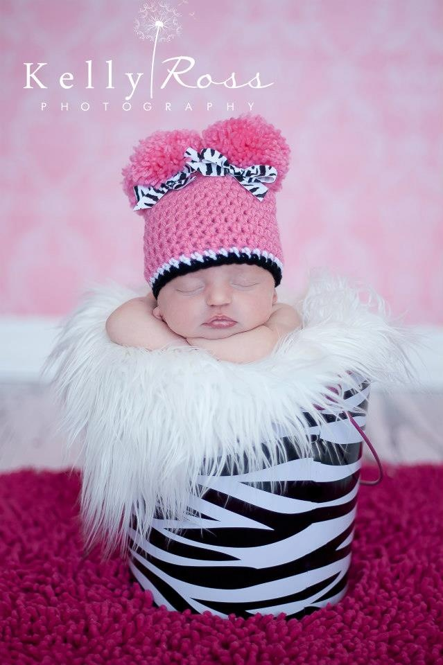 A adorable pom pom hat for any occasion.   http://ccphotographyprops.weebly.com/products3.html