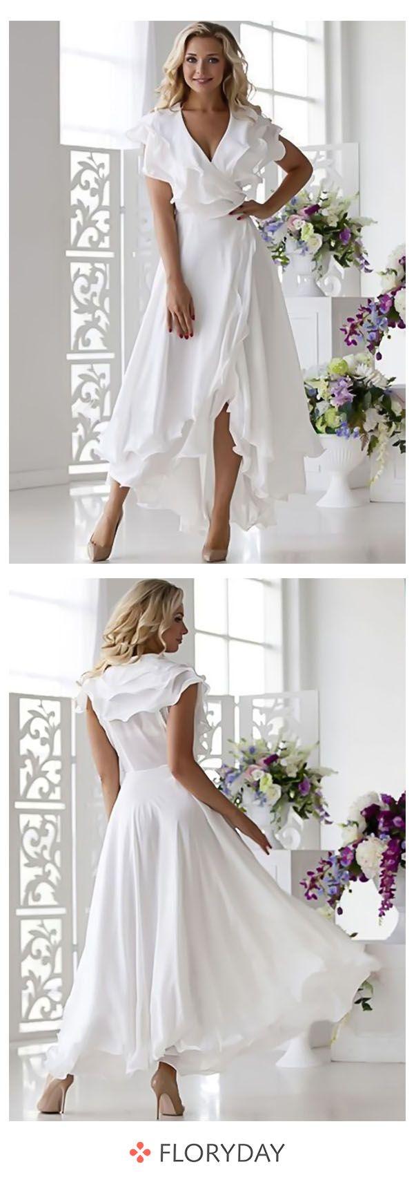 Asymmetrisches Kleid it kurzen Ärmel und Rüschen