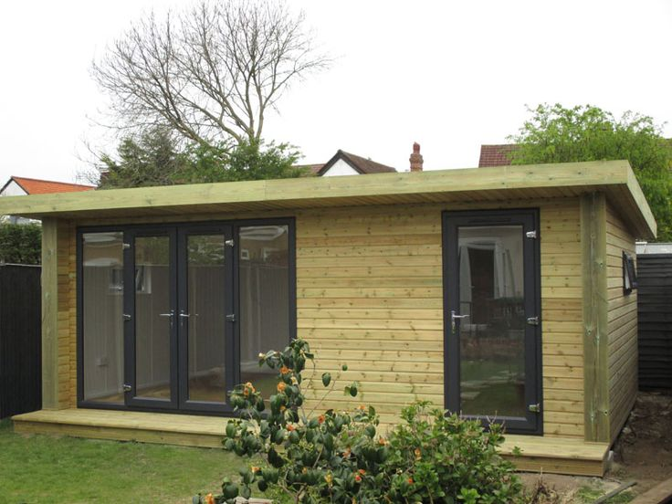 6x4m Expression garden room with 3m graphite French door combi & single entry door leading to partitioned space, from £20,495 (inc. VAT)