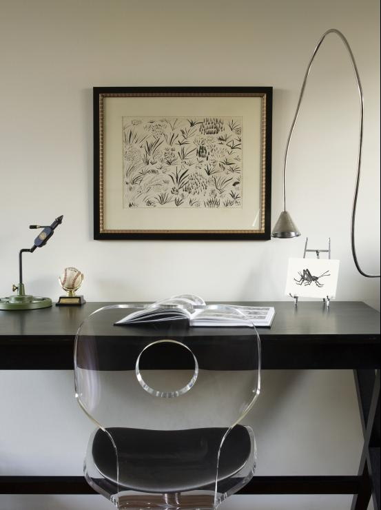 lucite chair see through to the striking black desk