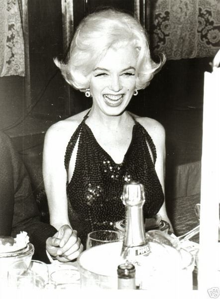 "Marilyn Monroe wearing Norman Norell, to the 1962 Golden Globes, winning the ""World's Favorite Film Star"" of 1961 award."