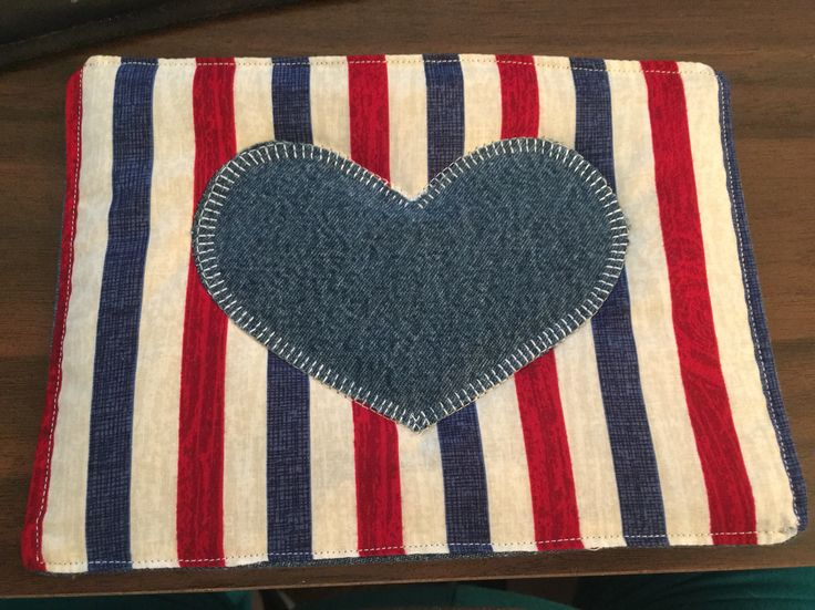 Mug Rug with red, white and blue stripped material. I used recycled denim on the back and on the heart.