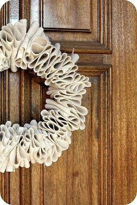 Burlap Wreath Tutorial.  The site also shows a red rosette embellishment.  VERY CUTE!