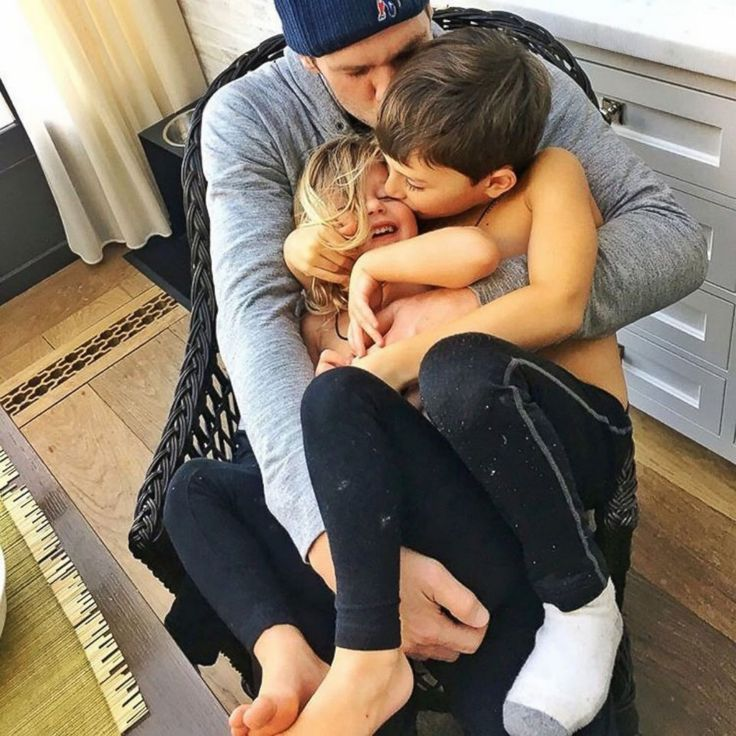 Tom Brady Cuddles With His Son and Daughter Gisele Bundchen shared this image of husband Tom Brady and their children to her Instagram account, Jan. 25, 2016.