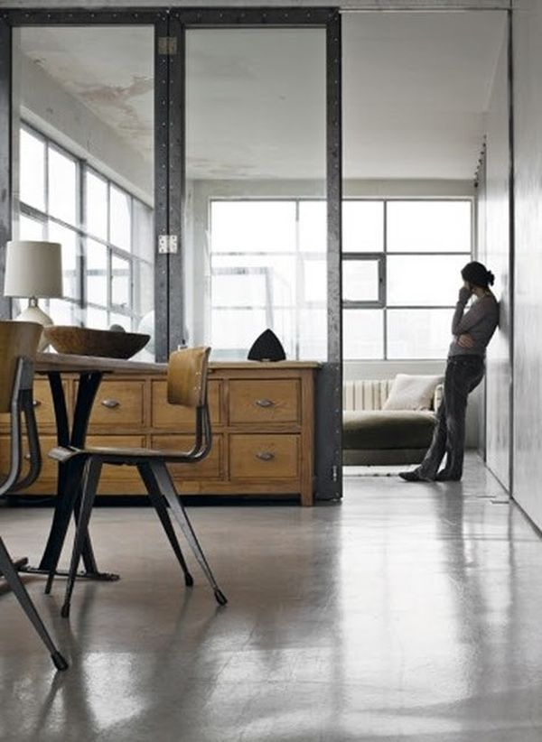 Wood and glass room divider that visually separates the spaces. This, I love.