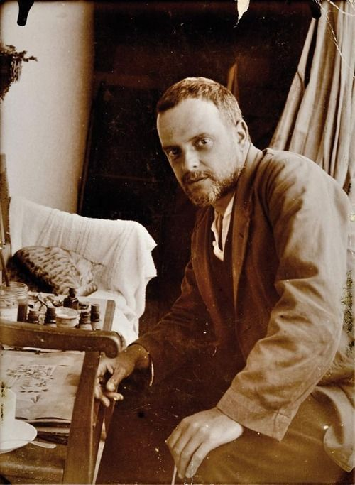"isis0isis:Paul Klee with his cat Skunk (Fripouille), in front of the oil drawing ""All Souls' Picture"" - taken by his son Felix Klee, 1921"