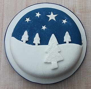 Christmas cake: snowy trees against a night sky