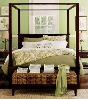 green bedroom with dark wood furniture