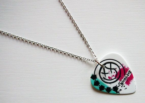 Hey, I found this really awesome Etsy listing at http://www.etsy.com/listing/160217948/guitar-pick-necklace-blink-182