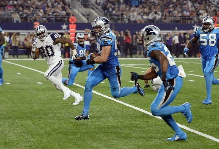Carolina Panthers' Luke Kuechly (59) looks to score a touchdown after intercepting a Dallas Cowboys' Tony Romo (9) pass in the second quarter at AT&T Stadium on Thursday, November 26, 2015. The Panthers led 23-3 at halftime.