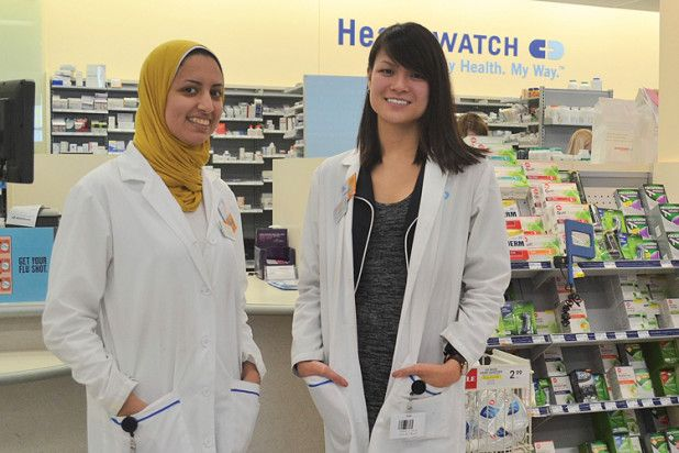 Helen Phan (r) with staff pharmacist Yasmin Abdalla (l) in the Shoppers pharmacy. TONY PEARSON Special to This Week