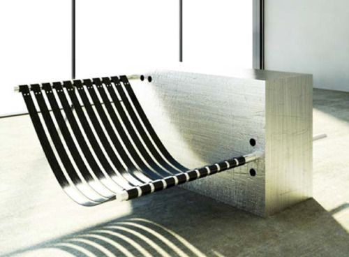 Cantilever Chair by Barrington Gohns  The user is able to adjust the angle of the seat by slotting the stainless steel bars, which the leather seat hangs off, in and out of cavities.