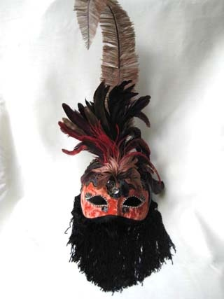 Si Lucia Araba Plume Orange Mask. Biggs Ltd. Gallery. Price $155. 1-800-362-0677.