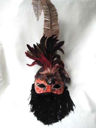 Si Lucia Araba Plume Orange Mask. Biggs Ltd. Gallery. Price $155. 1-800-362-0677.
