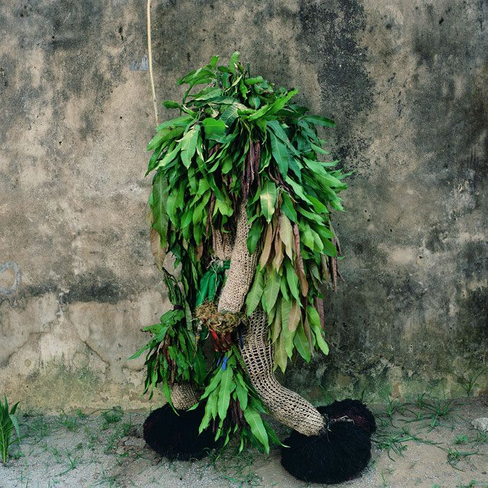 Phyllis Galembo, Minor Ekpe Masquerade with Mango Leaves, Calabar South, Nigeria, 2005, Ilfochrome, 30 x 30 inches