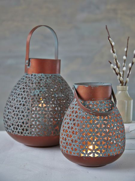 Aged Copper Lanterns  Makes me think of Chinese lantern lights a little bit. These are cute!