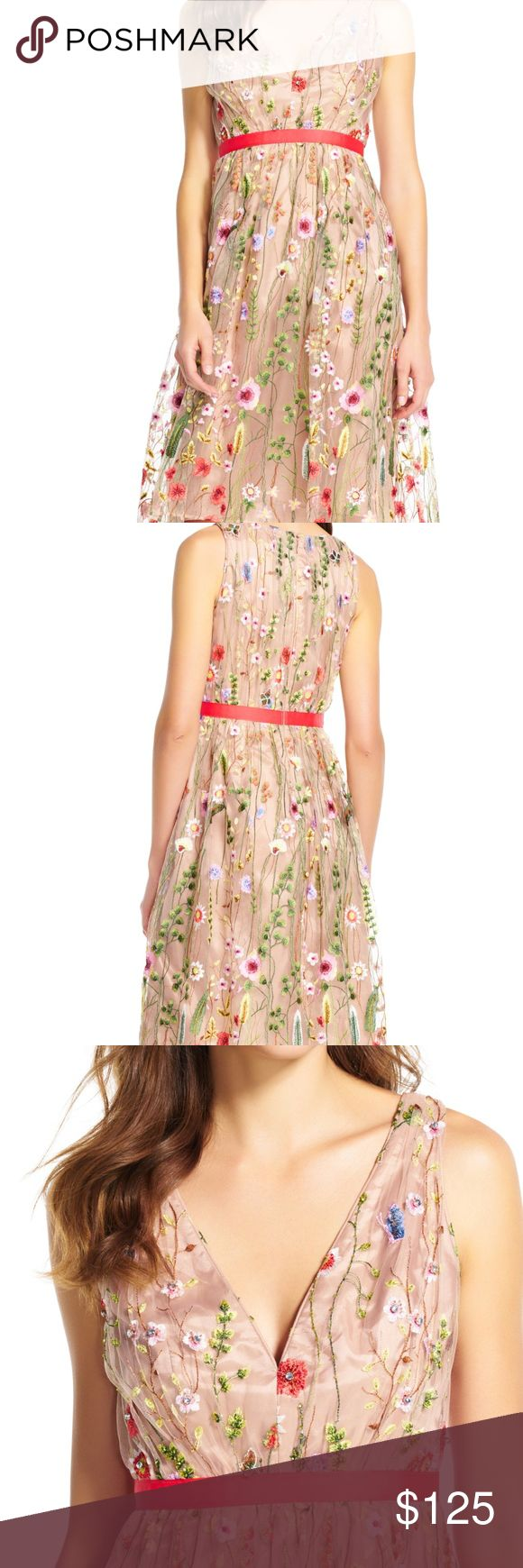 Adrianna Papell Boho Embroidered Fit Flare Dress Bright Fun floral embroidery has this dress hitting every trend this season.  Featuing a v-neckline; figure-enhancing empire waist; and a sleeveless bodice;  this romantic party dress will perfectly tend to your night out. Can be worn for special occasion formal like a wedding, can be worn and on trend currently with Doc Martens and a Moto leather jacket  Crafted from gauzy tulle; this style is simply stunning.  This party dress is complete…