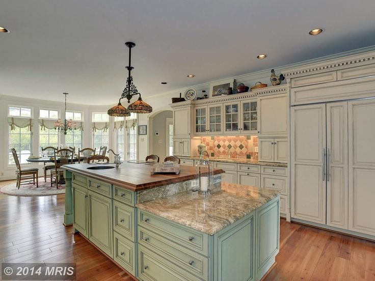 Cottage Kitchen with Kitchen island, One-wall, Undermount sink, Island with granite and wood counter top, Glass panel, Flush