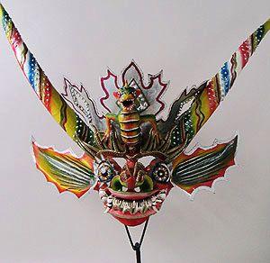 Devil mask    Carnival, Oruro, Bolivia    24 inches, painted papier mache, glitter, glass