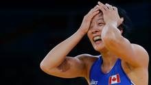 Carol Huynh of Canada, celebrates her win over Isabelle Sambou of Senegal after their 48-kg women's freestyle wrestling bronze medal match at the 2012 Summer Olympics, Wednesday, Aug. 8, 2012, in London. (AP)