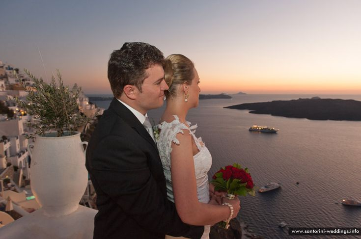 just married and enjoying the sunset and the Aegean sea