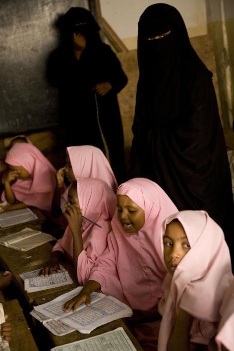 Kenya. Lamu. At the Thamaratul Jannah ( the Orchard of Paradise) madrassa, teachers in nigab (the full veil) in a class of girls wearing the hijab (head scarf).2007.