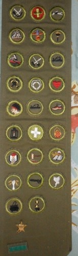 1952 Boy Scout Sash with 26 Merit Badges -  1952 Philmont Scout Ranch Badge, and - Junior League Conference Badge -, Plus Explorer Patrol Leader Badge. Several Rare Badges on Sash :  Vintage Cooking Merit Badge        Vintage Safety Merit Badge Badge        Vintage Basketry Merit Badge        Vintage Swimming Merit Badge        Vintage Rowing Boy Scout Merit Badge        Vintage Firemanship Merit Badge        Vintage Dog Care Merit Badge