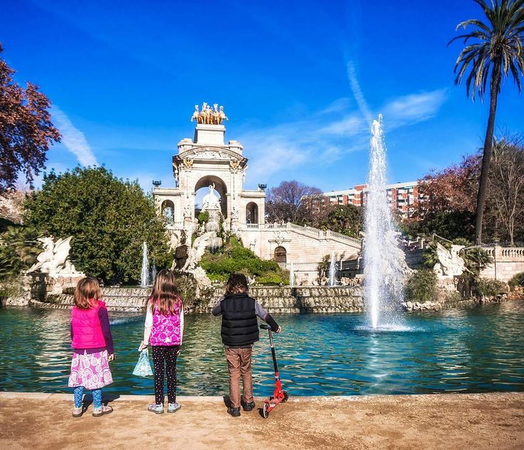 Taking in the extravagant Cascada Monumental in Barcelona's Ciutadella Park. With a zoo, multiple playgrounds, climbing trees, interactive sculptures like a giant mammoth, a pond with rentable rowboat, and beautiful lawns, the park is heaven for kids.