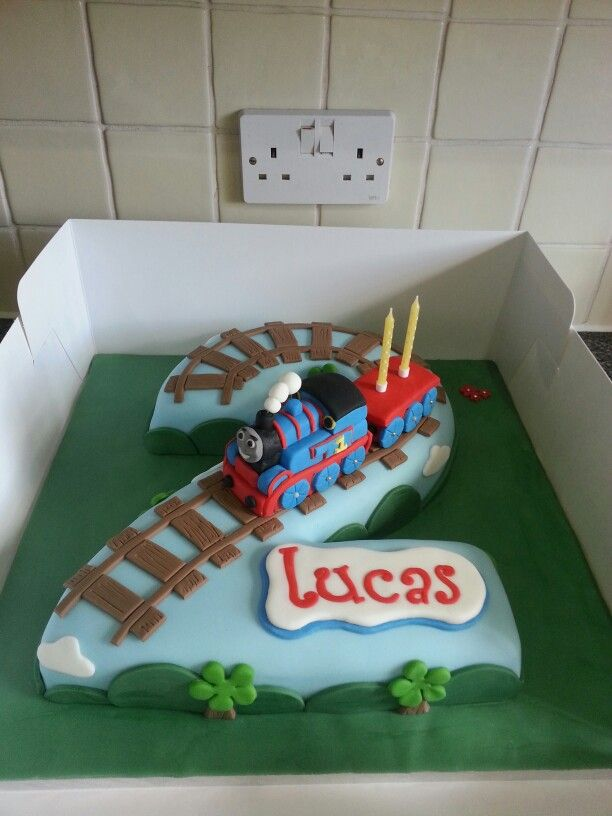 Thomas The Tank Engine cake.  Sticky toffee pudding flavour with caramel sauce.